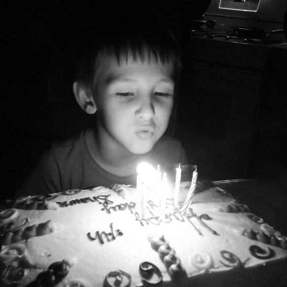birthday-boy-blowing-out-candles
